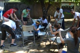 Our students washing chairs in Acahualinca Public School. They also washed windows and walls.