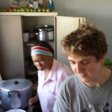 Working in the kitchen at Blikkiesdorp.