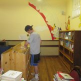 Helping create a library space at Filia Special Needs School.