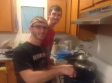 Ben and Andrew prepare dinner for the group.
