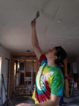 Felix helps finish the ceiling.