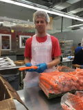 Brandon at Food and Friends, preparing fresh groceries (proportioned for giant rabbits?)